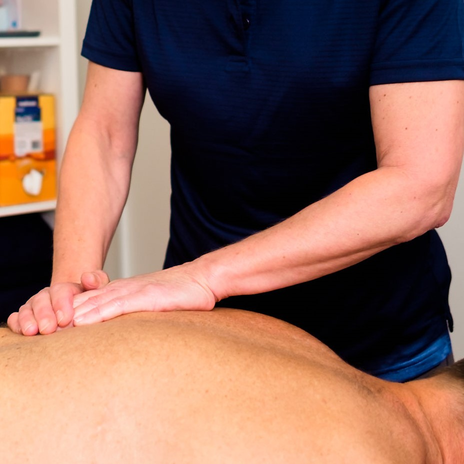 Therapist massaging mid-back